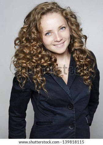 Portrait of young beautiful happy businesswoman - stock photo