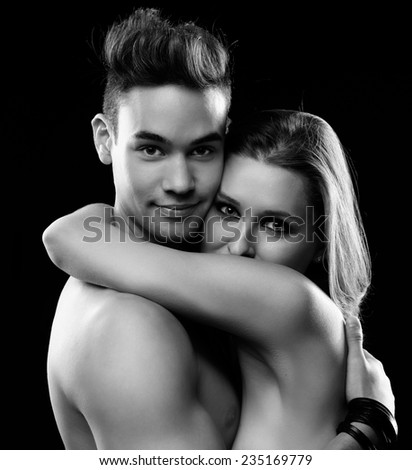 portrait of young beautiful happy couple on black - stock photo