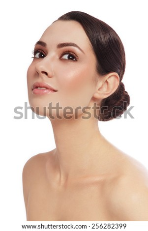 Portrait of young beautiful happy smiling woman looking upwards, over white background - stock photo