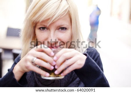 Portrait of young beautiful happy woman with ice tea - stock photo