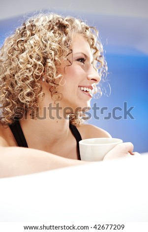 Portrait of young beautiful happy woman with tea - stock photo