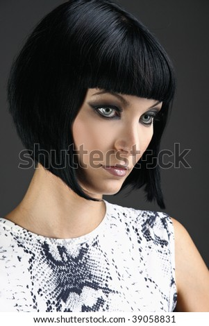 Portrait of young beautiful longhair brunette. Beauty makeup concept. Studio shot on dark background. - stock photo