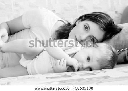 Portrait of young beautiful mum with the little boy - stock photo