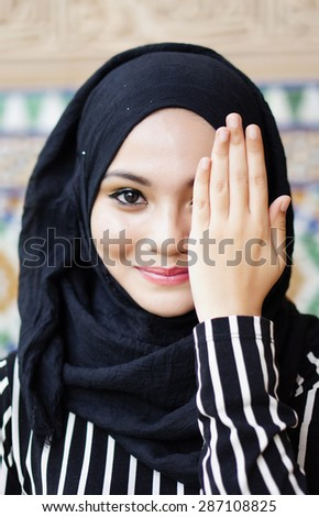 Portrait of young beautiful muslim woman - stock photo