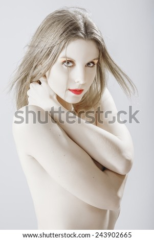 portrait of young beautiful naked pensive woman, toned image  - stock photo