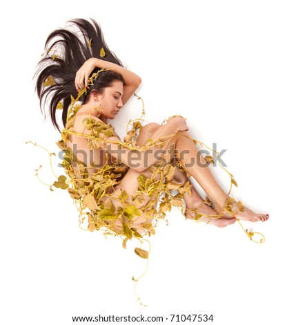 Portrait of young beautiful nude woman with yellow autumn ivy leaves wrapped around her on white background - stock photo