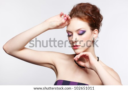 portrait of young beautiful red-haired woman touching her face with hands and closing eyes - stock photo