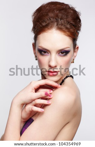 portrait of young beautiful red-haired woman with manicured hands looking over her shoulder - stock photo