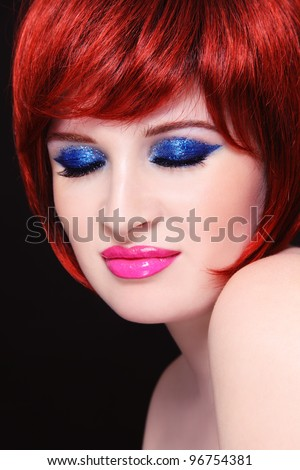 Portrait of young beautiful redhead woman with fancy sparkly make-up