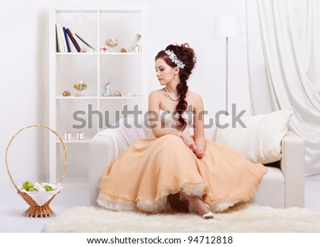 portrait of young beautiful retro woman in skirt with petticoat and corset posing in vintage interior - stock photo