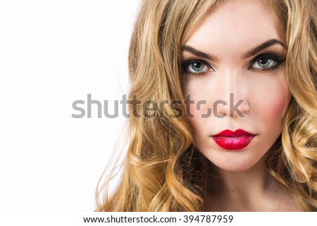 Portrait of young beautiful sexy girl with bright makeup. Face of the beautiful girl close up on a white background.