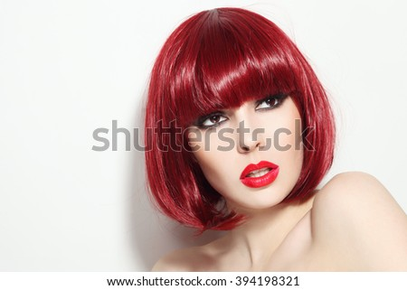 Portrait of young beautiful sexy red-haired girl with bob haircut and stylish make-up looking upwards - stock photo