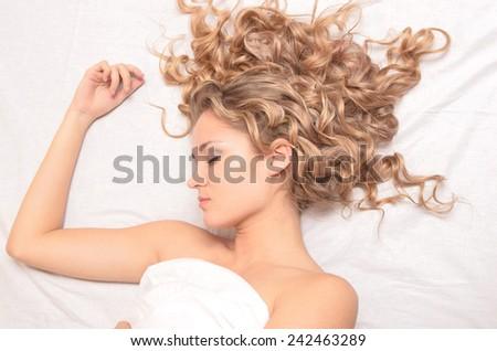 portrait of young beautiful sleeping woman - stock photo