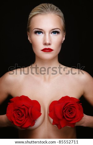 Portrait of young beautiful slim sexy woman with red roses in hands - stock photo