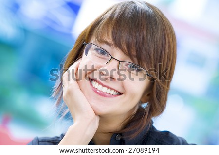 Portrait of young beautiful smiling  girl in office environment