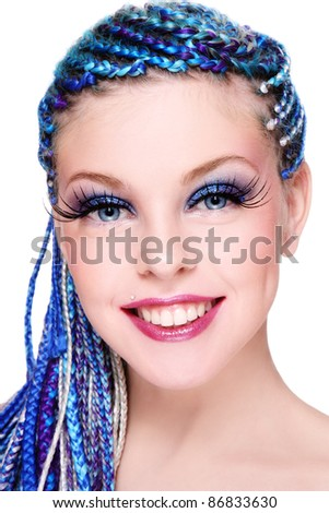 Portrait of young beautiful smiling girl with fancy blue hairstyle and extra long fake eyelashes - stock photo