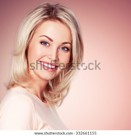 Portrait of young beautiful smiling girls. Cute girl looks into the camera - stock photo