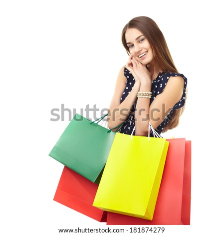 Portrait of young beautiful smiling happy woman with many colorful shopping bags isolated on white background - stock photo