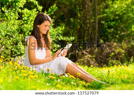 Portrait of young beautiful smiling woman with tablet pc