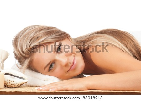 Portrait of young beautiful spa woman  lying on bamboo mat and relaxing - stock photo