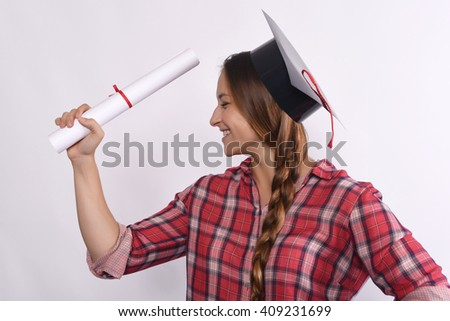 Portrait of young beautiful student happy with her diploma and graduation cap. Isolated white background. - stock photo