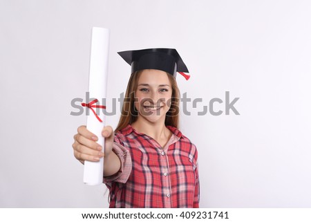Portrait of young beautiful student with diploma and graduation cap. Isolated white background. - stock photo