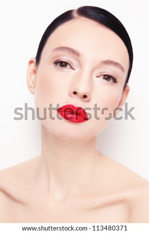 Portrait of young beautiful stylish woman with red lipstick over white wall - stock photo