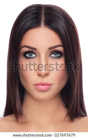 Portrait of young beautiful tanned brunette with long straight hair and stylish make-up over white background - stock photo