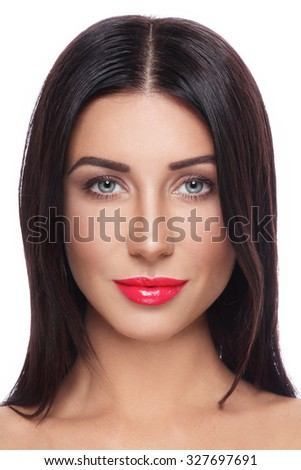 Portrait of young beautiful tanned woman with long straight hair and red lipstick over white background - stock photo