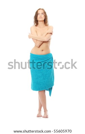 Portrait of young beautiful topless caucasian woman with blue towel around her waist, isolated on white background - stock photo