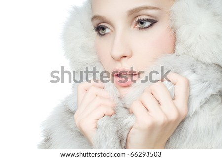 Portrait of young Beautiful wearing white fur - stock photo