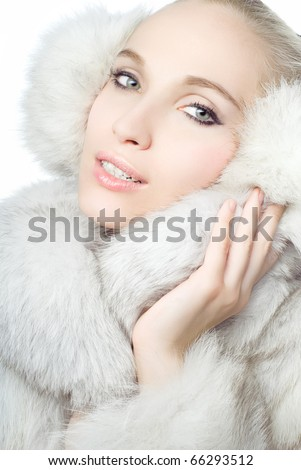 Portrait of young Beautiful wearing white fur - stock photo