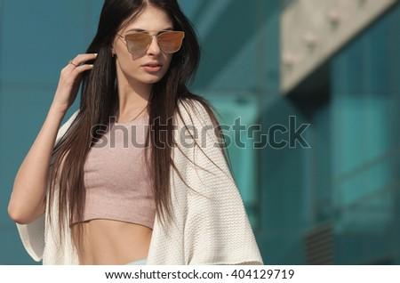 Portrait Of Young  Beautiful Woman. beautiful young brunette fashion model posing outdoor. Summer outdoor portrait. Focus on woman, blurred background. - stock photo