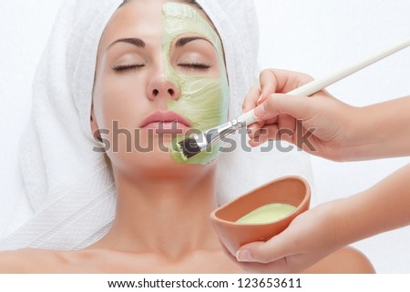 portrait of young beautiful woman  being treated - stock photo