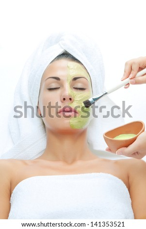 portrait of young beautiful woman  being treated