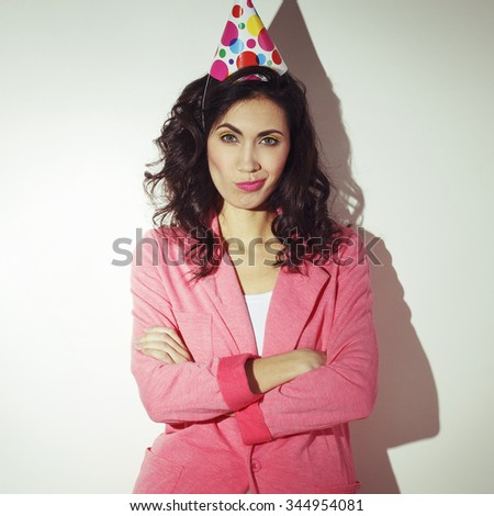 Portrait of young beautiful woman celebrating her birthday - stock photo