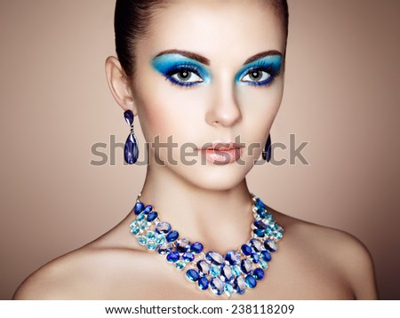 Portrait of young beautiful woman close up. Perfect makeup. Perfect skin. Fashion photo - stock photo