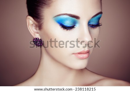 Portrait of young beautiful woman close up. Perfect makeup. Perfect skin. Fashion photo