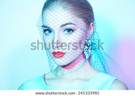 Portrait of young beautiful woman close up. Perfect makeup. Perfect skin. Fashion photo. - stock photo