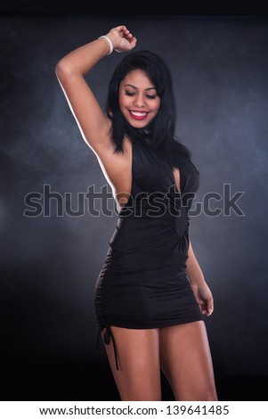 Portrait Of Young Beautiful Woman Dancing In Elegant Dress - stock photo