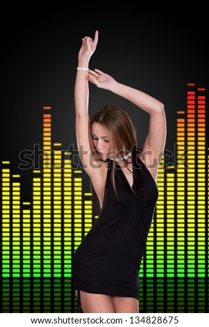Portrait Of Young Beautiful Woman Dancing With Equalizer On Background - stock photo