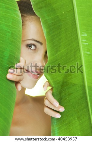 Portrait of young beautiful woman getting through the jungle