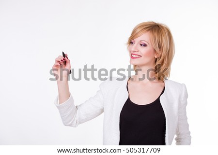 Portrait of young beautiful woman holding a pen on white background. Writing concept.
