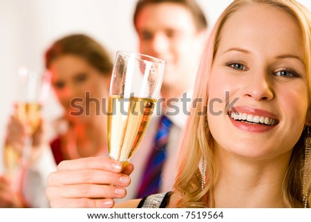 Portrait of young beautiful woman holding the glass of champagne - stock photo