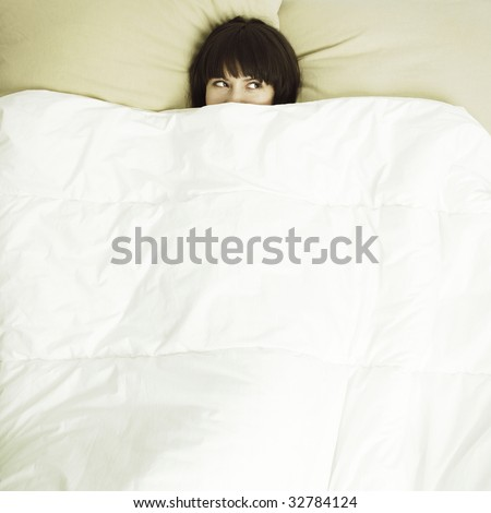 Portrait of  young beautiful woman in bed - stock photo