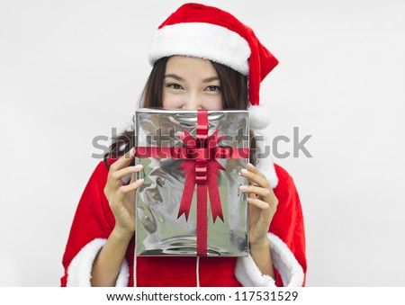 Portrait of young beautiful woman in santa claus hat with grey christmas gift box with red ribbons. - stock photo