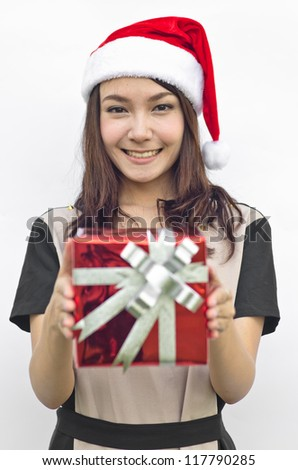 Portrait of young beautiful woman in santa claus hat with red christmas gift box with grey ribbons.