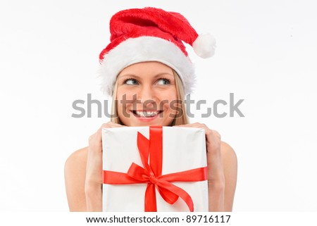 Portrait of young beautiful woman in santa claus hat with white christmas gift box with red ribbons. - stock photo