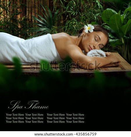 portrait of young beautiful woman in spa environment. Banner, extra space for your text. - stock photo