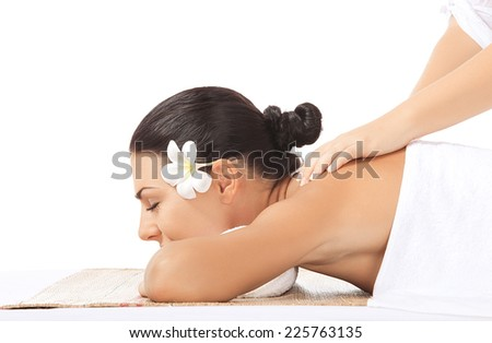 portrait of young beautiful woman in spa on white back - stock photo